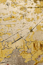 Cracked yellow surface with paint splashes Stock Image