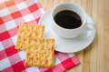 Cracker cookie and hot coffee Royalty Free Stock Photo