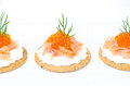 Crackers with cream cheese salted salmon and red caviar appetizer on a white background horizontal closeup Royalty Free Stock Image