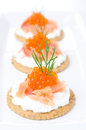 Crackers with cream cheese salted salmon and red caviar closeup close up selective focus vertical Royalty Free Stock Photos