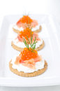 Crackers with cream cheese salted salmon and red caviar on the white plate Royalty Free Stock Photography
