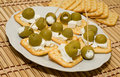 Crackers with olives and cheese feta Stock Photography