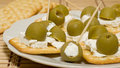 Crackers with olives and cheese feta Stock Images
