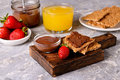 crackers spread with Chocolate Hazelnut Filling and Strawberries Royalty Free Stock Photo
