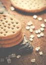 Crackers stack together on black stone, coarse sugar on wooden b Royalty Free Stock Photo