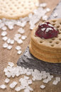 Crackers stack together with jam on top on black stone, coarse s Royalty Free Stock Photo