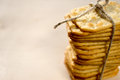 Crackers stacked and tied with a rope on the table Royalty Free Stock Images