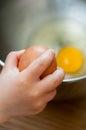 Cracking an egg in a bowl Stock Photos