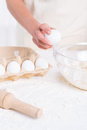 Cracking an egg close up of woman for pastry Stock Image