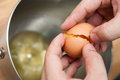 Cracking eggs and seperate yolk from albumen food preparation Royalty Free Stock Photo