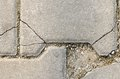 Crackled pave stone with dirt concrete path texture Royalty Free Stock Photos