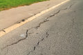 Cracks in the asphalt pavement closeup