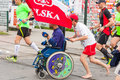 Cracovia marathon runners on the city streets on may in krakow poland unidentified handicapped man a wheelchair Stock Images