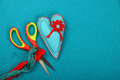 Craft and art felt toy heart thread and scissors one blue handmade stitched red on teal background Stock Images