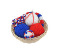 Craft basket containing wool knitting pompom etc Royalty Free Stock Photography