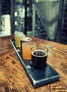 Craft beer flight and microbrewed samples at a local small scale brewery Stock Photos