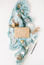 Craft envelope `happy summer cards` on blue textile with stones, dry rose and branches on white background Royalty Free Stock Photo