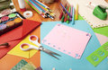 Craft table with a lot of things the top is made wood on the scissors colored pencils construction paper and color Stock Photo