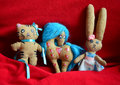 Craft toys handmade by a child cat rabbit and horse on red background Stock Images