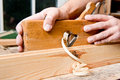 Craftmans hand with planer a on his workbench Royalty Free Stock Photo