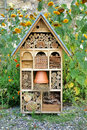 Craftsman built insect hotel decorative wood house with compartments and natural components refuge made to protect and promote Royalty Free Stock Photos