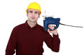 Craftsman with a chainsaw witha over his shoulder Stock Photography
