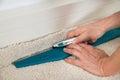Craftsman cutting carpet Royalty Free Stock Photo