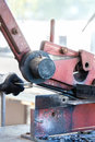 Craftsman cutting metal with shear skip in workshop Stock Images