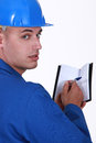 Craftsman holding an agenda paper Royalty Free Stock Images