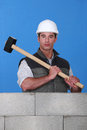 Craftsman holding a huge hammer strong Stock Images