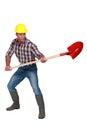 Craftsman holding a shovel red Stock Images