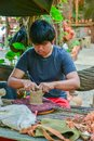 Craftsman making pottery of dolls and sculpture of animals Royalty Free Stock Photo