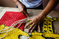 Craftsman making a rope tapestry rug Stock Image