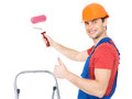 Craftsman painter stands stairs roller showing thumbs up sign full portrait over white background Stock Photography
