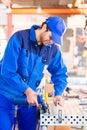 Craftsman rivet metal in workshop