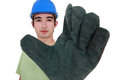 Craftsman wearing gloves blue hard hat Stock Image