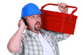 Craftsman wearing headphones and carrying a tool box Royalty Free Stock Photography