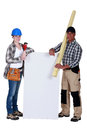 Craftswoman and craftsman holding an ad board Stock Photo