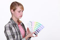 Craftswoman holding a color chart Royalty Free Stock Photo