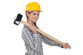 Craftswoman holding a huge hammer Royalty Free Stock Photo
