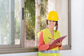 Craftswoman holding a notepad and writing woman at work in construction Stock Images