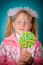 Crafty girl with big lollipop Stock Photography