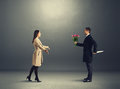 Crafty man with flowers and knife men waiting young woman Royalty Free Stock Photography