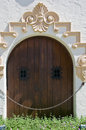 Crafty wooden door with small windows Royalty Free Stock Image