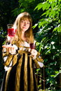 Crafty young woman in renaissance dress Stock Photo