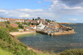 Crail harbour from fife coastal footpath scotland view looking north east the towards the small picturesque at in the kingdom of Royalty Free Stock Photography