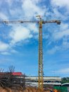 Crain construction building in blue sky and clound Stock Photos
