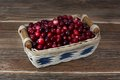 Cranberries in a basket on wooden table Stock Photography