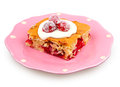 Cranberries dessert with orange peel and cream cheese topping on pink plate on white Royalty Free Stock Image