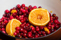 Cranberries and orange making cranberry sauce for homemade Royalty Free Stock Photography